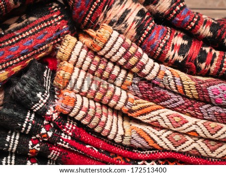 Pile of folded kilim rugs as a background - stock photo