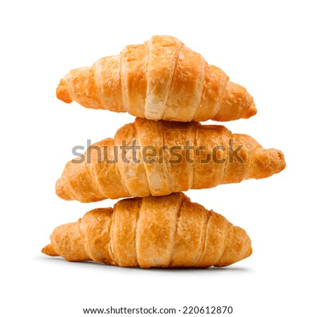 pile of fresh and delicious croissants on a white background - stock photo