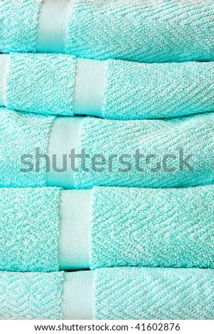 Pile of fresh and soft bath towels