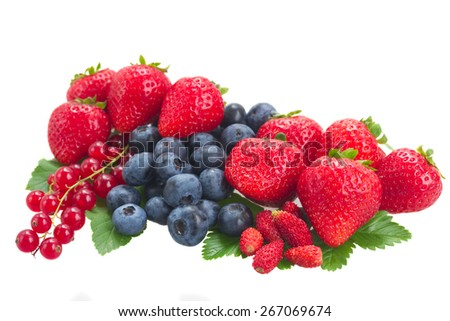 pile of  fresh berries with green  leaves  isolated on white background - stock photo