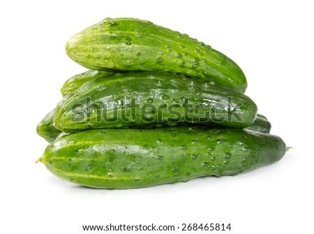 Pile of fresh cucumbers isolated on white background - stock photo