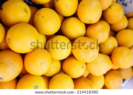 pile of fresh orange fruit in the fruit market