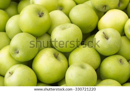 Pile of fresh organic green apples ready for eating or cooking