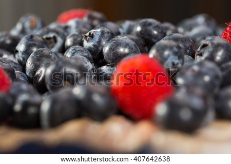 Pile of fresh raspberry and blueberry fruit - stock photo
