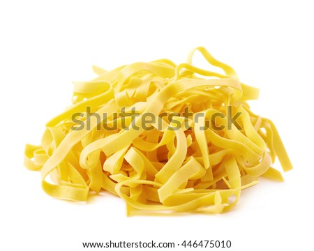 Pile of fresh raw fettuccine ribbon pasta isolated over the white background - stock photo