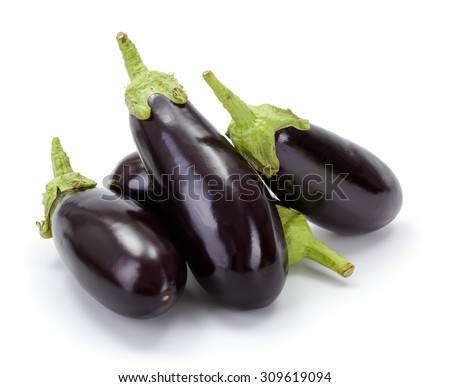 Pile of fresh ripe eggplants (Solanum melongena) on white