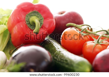 Pile of fresh vegetables  on wooden surface - stock photo