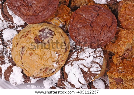 Pile of freshly baked, home-made chocolate chip, chocolate and chocolate crinkle cookies