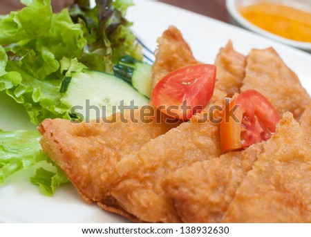 pile of fried bread with Fresh Vegetables.