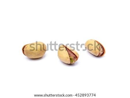 Pile of fruit pistachios isolated on white background  - stock photo