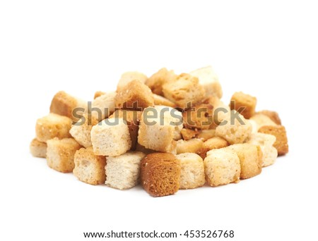 Pile of garlic white bread croutons isolated over the white background - stock photo