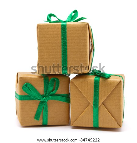 Pile of Gift boxes wrapped in brown paper isolated on white. - stock photo