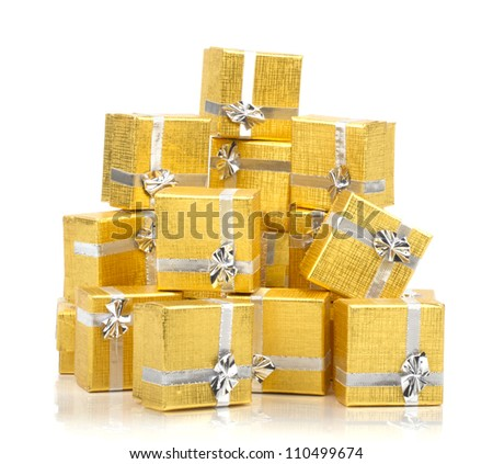 Pile of gold gifts on white