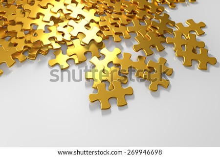 pile of gold puzzle elements scattered on the surface - stock photo