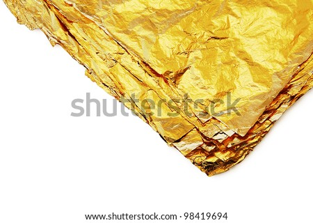 pile of gold sheets on a white background - stock photo
