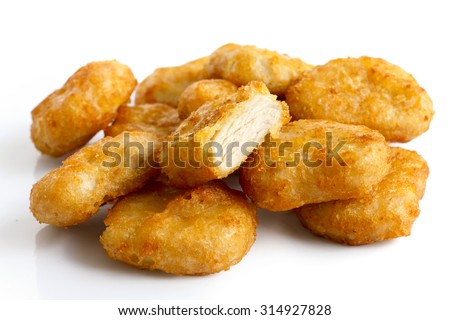 Pile of golden deep-fried battered chicken nuggets isolated on white. One cut with meat showing.