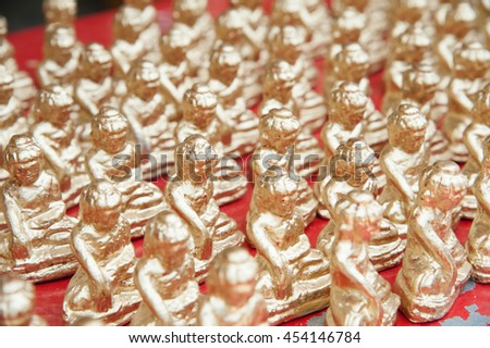 Pile of golden  little Myanmar statue - stock photo