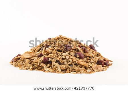 Pile of granola cereal with raisins and nuts on white
