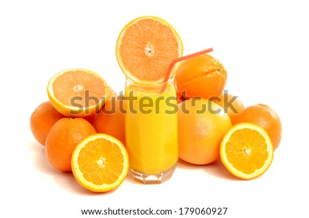 Pile of grapefruits and oranges with a glass of fresh grapefruit juice. Citrus fruit isolated on white background.