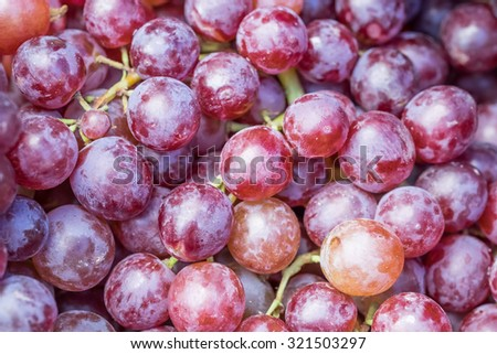 Pile of grapes sold at fruit market.  Image has grain or blurry or noise and soft focus when view at full resolution.