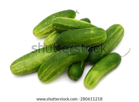 pile of green cucumbers isolated on white