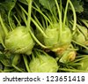 Pile of Green Kohlrabi at the farmers market - stock photo