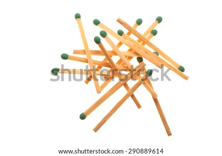 Pile of green wooden matches isolated on white background - stock photo