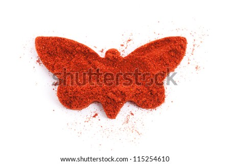Pile of ground Paprika isolated in butterfly shape on white background. Used to color rices, stews, and soups, meats. - stock photo