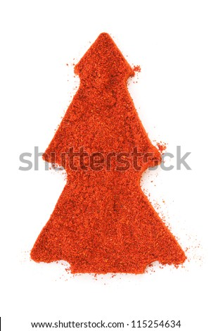 Pile of ground Paprika  isolated in christmas tree shape on white background. Used to color rices, stews, and soups, meats. - stock photo