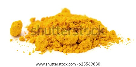 Pile of ground turmeric on a white background, shallow DOF.