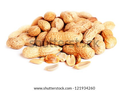 Pile of groundnuts on a white background