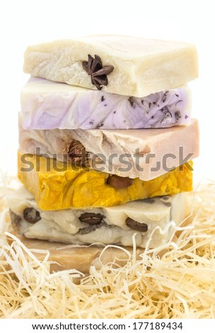 Pile of handmade colorful soap in the nest  isolated white background - stock photo