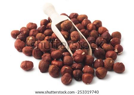 Pile of hazelnut nuts, isolated on white background - stock photo