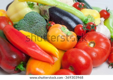 Pile of healthy vegetables - tomato, parsley, chilli pepper, pepper, garlic, eggplant and broccoli. - stock photo