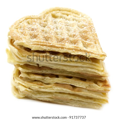 Pile of heart shaped waffles with sugar on white - stock photo