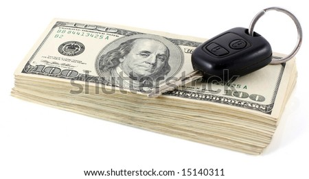 Pile of hundred dollar notes with a key from the car,  isolated on white - stock photo