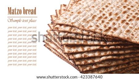 Pile of Jewish Matza Flatbread macro isolated on white background horizontal. text - stock photo