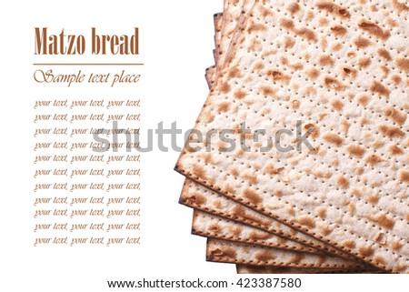 Pile of Jewish matzo Flatbread isolated on white background, horizontal - stock photo