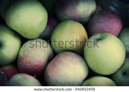 Pile of juicy ripe fall mcintosh apples at local farmers market - stock photo