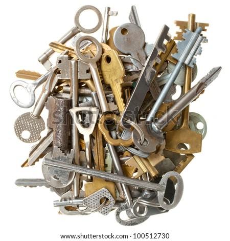 pile of keys isolated on white background - stock photo