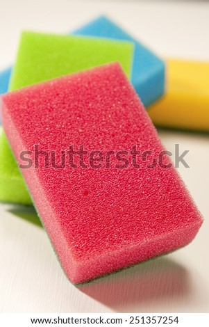 Pile of Kitchen Colorful Sponges On White Surface. Vertical Image Composition - stock photo