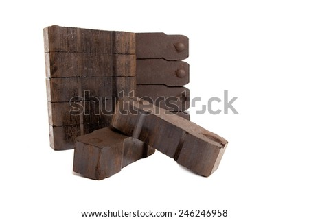 pile of lignite with two carbon bricks in front, white background, isolated, copy space - stock photo