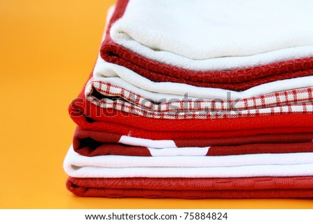 Pile of linen kitchen towels with space for your text - stock photo