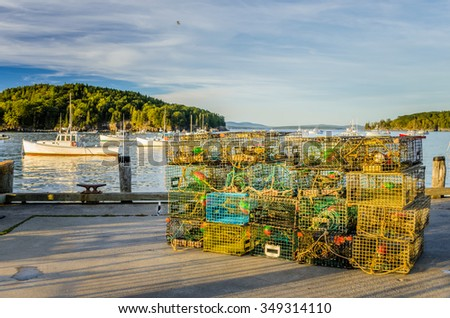 Pile of Lobster Pots on a Pier at Sunset - stock photo