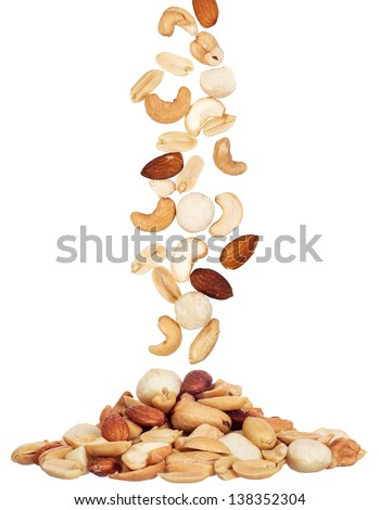 pile of macadamia, almond and cashew nuts isolated on white background - stock photo