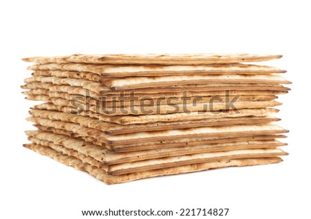 Pile of machine made matza flatbread, composition isolated over the white background