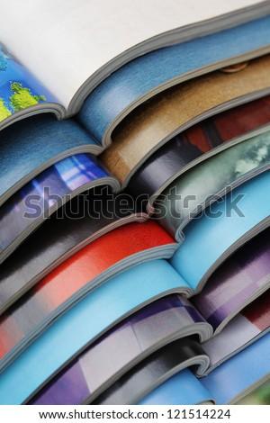 pile of magazines - colorful - stock photo