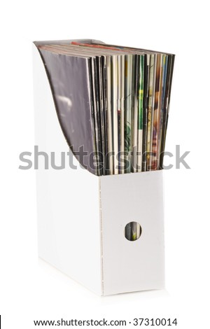 Pile of magazines nicely put away in a box, isolated on white. - stock photo