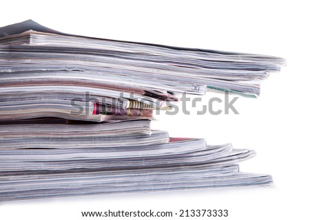 Pile of magazines on the table.