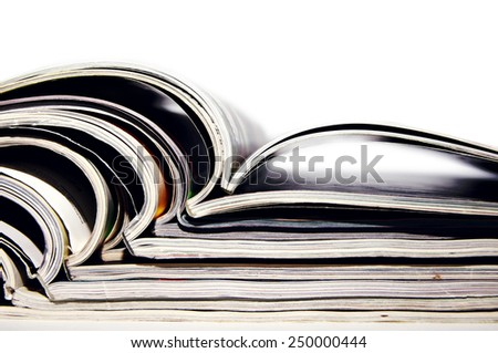 pile of magazines with open pages on a white background - stock photo